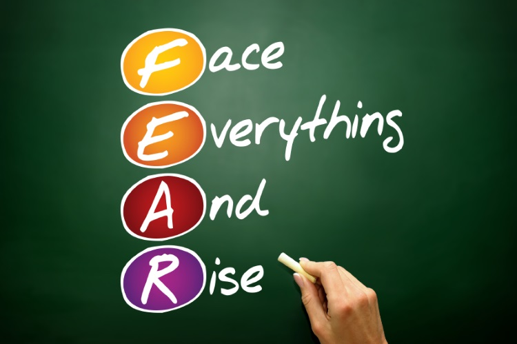 Face Everything And Rise (FEAR), business concept acronym on blackboard